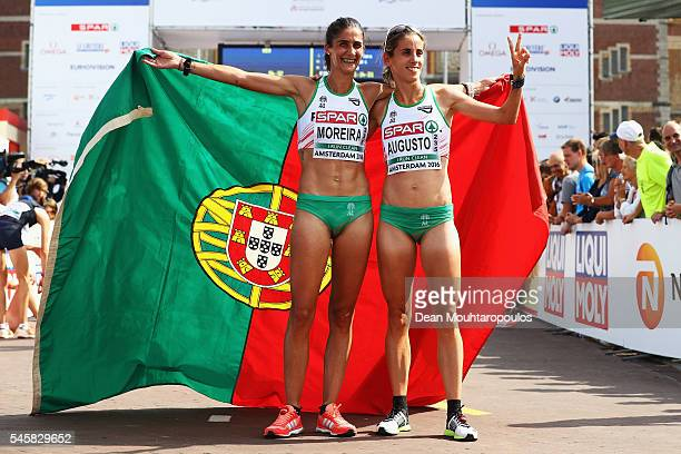 Sara Moreira of Portugal celebrates after she wins the gold medal in the Half Marathon Women with team mate and Jessica Augusto who won bronze on day...