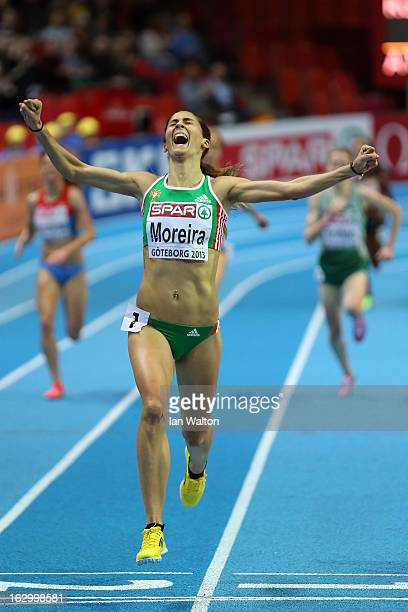 Sara Moreira of Portugal crosses the line to win gold in the Women's 3000m Final during day three of European Indoor Athletics at Scandinavium on...