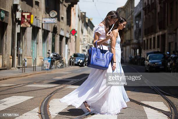 Sara Nicole Rossetto and Giorgia Rossetto wear Charo Ruiz Ibiza dresses and Sarah carries a Celine bag during Milan Men's Fashion Week Spring/Summer...