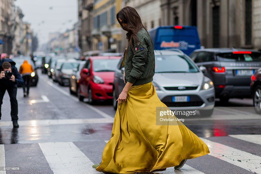 Sara Nicole Rossetto wearing a green bomber jacket and a yellow long dress seen outside Blumarine during Milan Fashion Week Fall/Winter 2016/17 on...