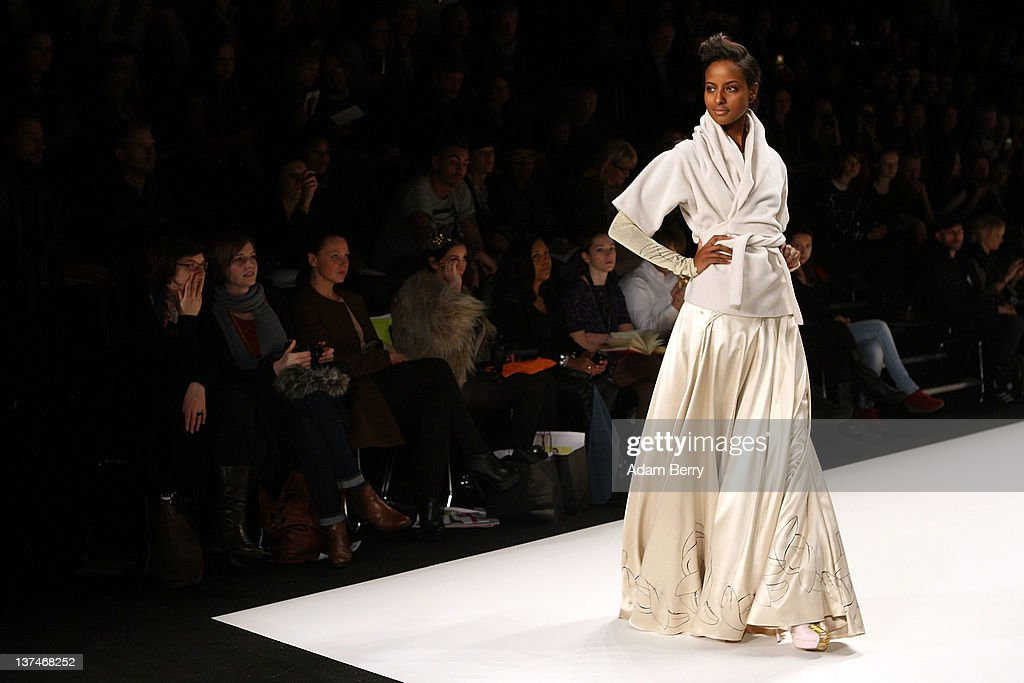 <a gi-track='captionPersonalityLinkClicked' href=/galleries/search?phrase=Sara+Nuru&family=editorial&specificpeople=5862409 ng-click='$event.stopPropagation()'>Sara Nuru</a> wearing Lena Criveanu walks the runway at the Romanian Designers Autumn/Winter 2012 fashion show during Mercedes-Benz Fashion Week Berlin at Brandenburg Gate on January 21, 2012 in Berlin, Germany.