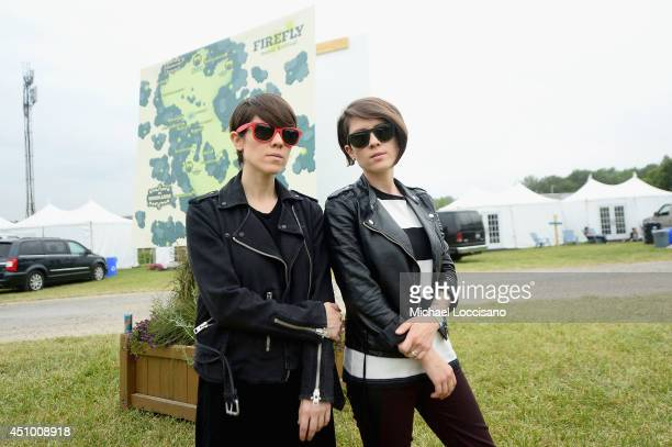 Sara Quin and Tegan Quin of Tegan and Sara pose backstage during day 3 of the Firefly Music Festival on June 21 2014 in Dover Delaware