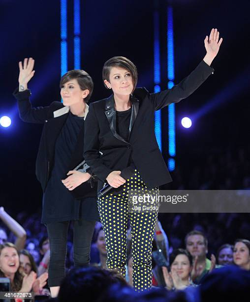 Sara Quin and Tegan Quin of Tegan and Sara win awards for Single of the Year Group of the Year and Pop Album of the Year at the 2014 Juno Awards held...