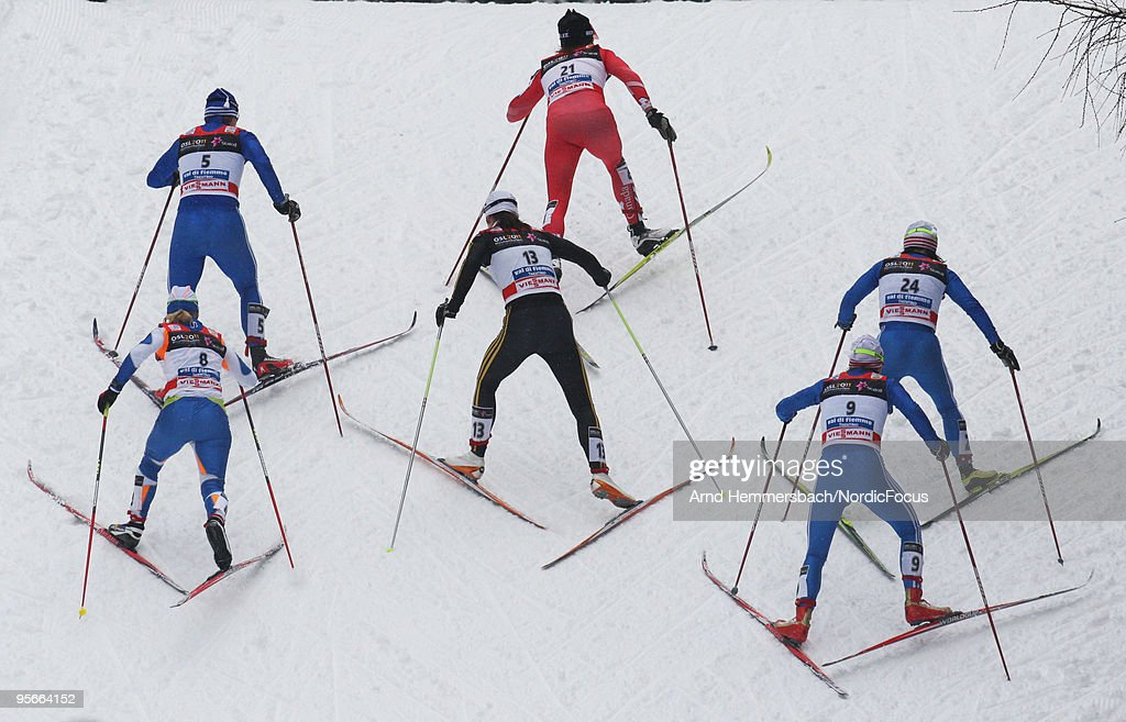 <a gi-track='captionPersonalityLinkClicked' href=/galleries/search?phrase=Sara+Renner&family=editorial&specificpeople=773721 ng-click='$event.stopPropagation()'>Sara Renner</a> of Canada leads a group, behind her compete (L-R) <a gi-track='captionPersonalityLinkClicked' href=/galleries/search?phrase=Alena+Sidko&family=editorial&specificpeople=776333 ng-click='$event.stopPropagation()'>Alena Sidko</a> of Russia, <a gi-track='captionPersonalityLinkClicked' href=/galleries/search?phrase=Katrin+Zeller&family=editorial&specificpeople=4001111 ng-click='$event.stopPropagation()'>Katrin Zeller</a> of Germany and Evgenia Medvedeva of Russia during the mass women for the FIS Cross Country World Cup Tour de Ski on January 09, 2010 in Val di Fiemme, Italy.