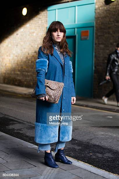Sara Reverberi wears a denim furlined FleaMaddona coat Beyond Retro sparkly jumper vintage jeans Portamento blue boots and a animal print purse...