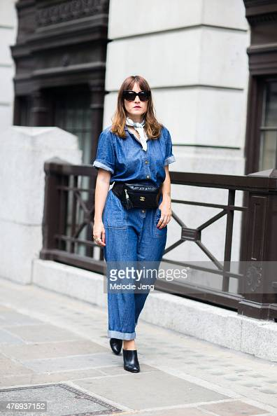 Sara Reverberi wears a vintage denim jumpsuit and Chanel fannypack during The London Collections Men SS16 at on June 12 2015 in London England