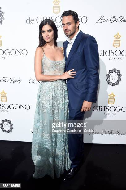 Sara Sampaio and Oliver Ripley attend DeGrisogono 'Love On The Rocks' during the 70th annual Cannes Film Festival at Hotel du CapEdenRoc on May 23...
