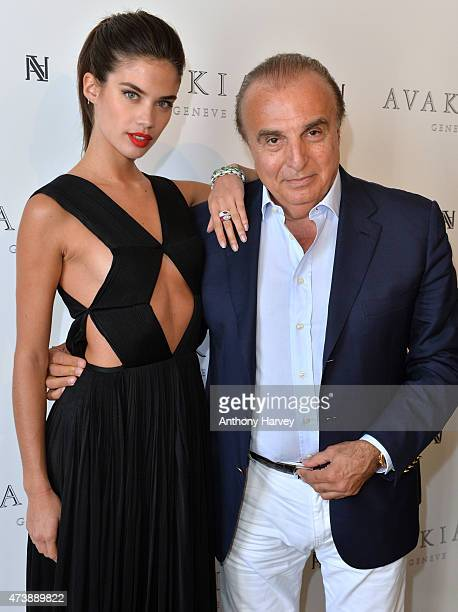 Sara Sampaio poses with Edmond Avakian as she visits the Avakian suite during the 68th Annual Cannes Film Festival at Carlton Hotel on May 18 2015 in...