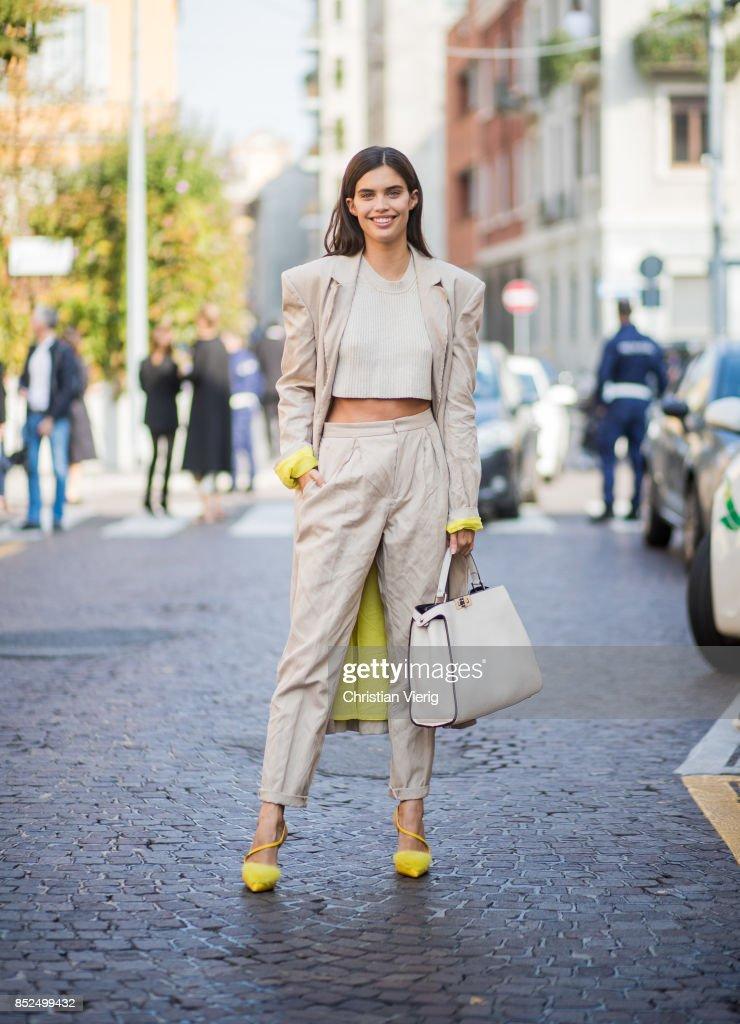 Sara Sampaio wearing creme pants, coat and cropped top, bag is seen outside Bottega Veneta during Milan Fashion Week Spring/Summer 2018 on September 23, 2017 in Milan, Italy.