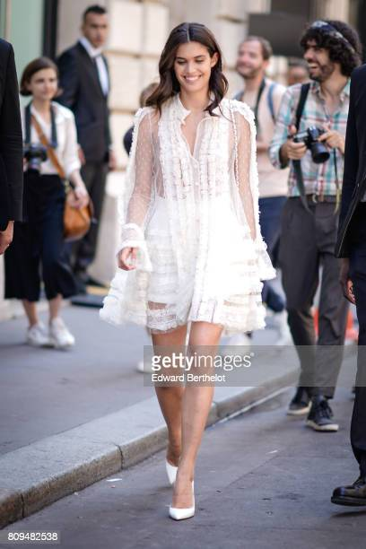 Sara Sampaio wears a white lace dress outside the Elie Saab show during Paris Fashion Week Haute Couture Fall/Winter 20172018 on July 5 2017 in Paris...