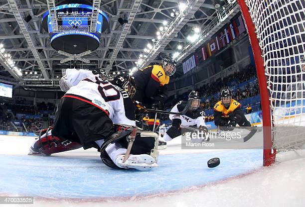 Sara Seiler of Germany scores against Nana Fujimoto of Japan in the second period during the Women's Classifications Game on day 11 of the Sochi 2014...