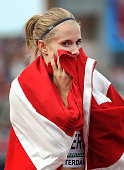 Sara Slott Petersen of Denmark celebrates after winning gold in the final of the womens 400m hurdles during day five of The European Athletics...