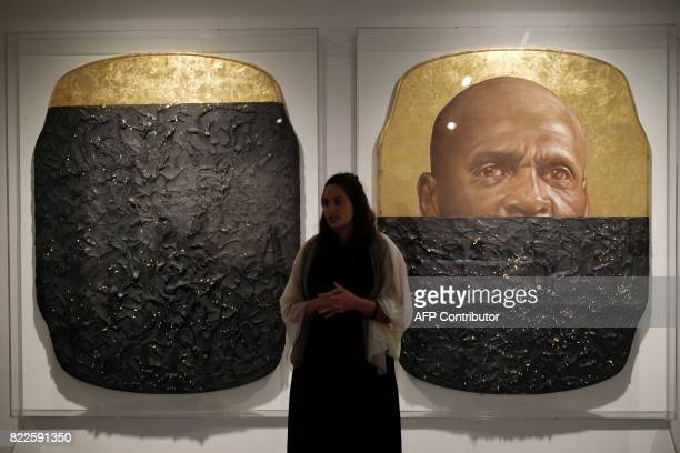 Sara Softness assistant curator of special projects speaks standing next to an artwork which is part of 'The Legacy of Lynching Confronting Racial...