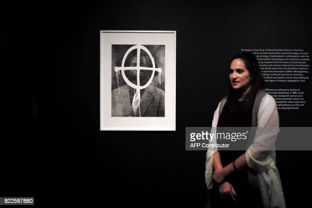 Sara Softness assistant curator special project speaks standing next to an artwork which is part of 'The Legacy of Lynching Confronting Racial Terror...