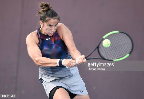 Sara Sorribes Tormo of Spain hits a backhand during the Women's Singles qualification match against Kristie Ahn of the United States at the 2017...