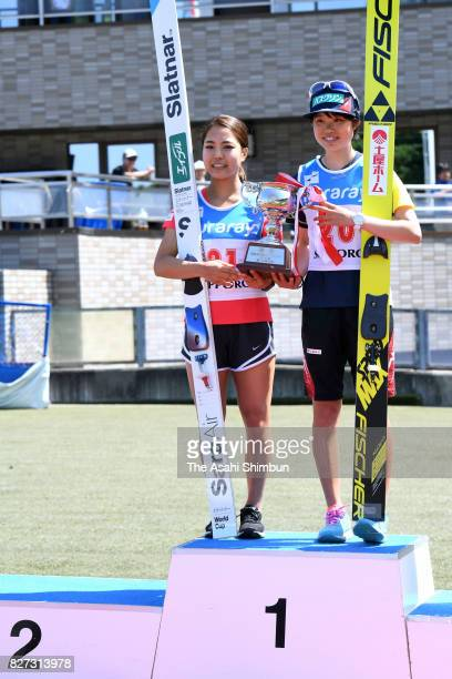 Sara Takanashi and Yuki Ito celebrate as they share the gold medals in the Okurayama Summer Ski Jumping Championship at Okurayama Jump Stadium on...