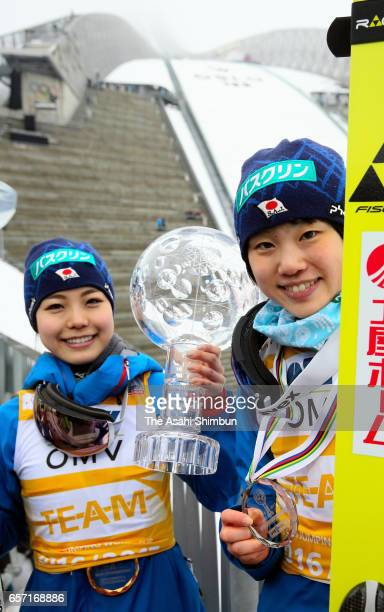 Sara Takanashi and Yuki Ito of Japan celebrate after day two of the FIS Ski Jumping World Cup Oslo on March 12 2017 in Oslo Norway