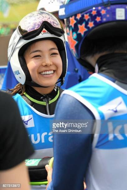Sara Takanashi celebrates winning the gold medal with Yuki Ito in the Okurayama Summer Ski Jumping Championship at Okurayama Jump Stadium on August 5...