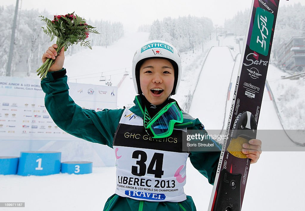 Sara Takanashi of Japan celebrates after winning the Ladies Ski Jumping HS 100 at the flower ceremony of the FIS Nordic Junior & U23 World Championships at Jested on January 24, 2013 in Liberec, Czech Republic.