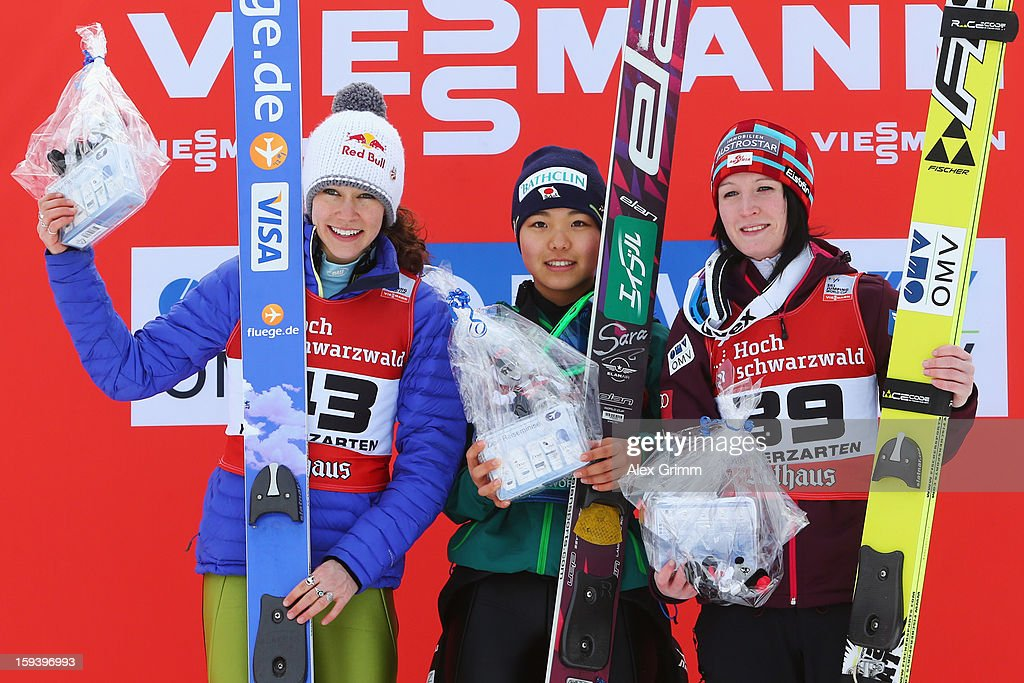 Sara Takanashi (C) of Japan celebrtaes with second placed Sarah Hendrickson (L) of the USA and third placed Jacqueline Seifriedsberger of Austria after winning the FIS Ski Jumping World Cup Women's HS108 on January 13, 2013 in Titisee-Neustadt, Germany.