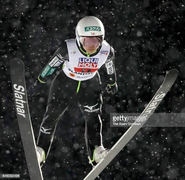 Sara Takanashi of Japan competes in the second jump of the Mixed Team HS100 Normal Hill Ski Jumping during the FIS Nordic World Ski Championships on...