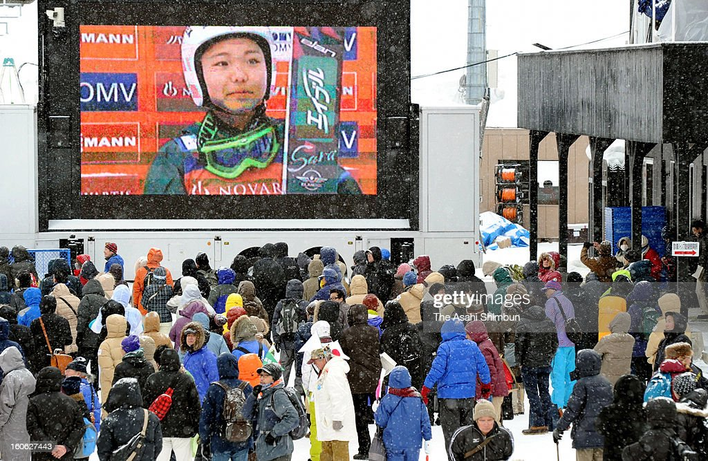 Sara Takanashi of Japan is on the display while ski jumping fans watch during day two of the FIS Women's Ski Jumping World Cup at Miyanomori Jump Stadium on February 3, 2013 in Sapporo, Japan.