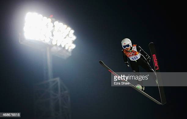 Sara Takanashi of Japan jumps during the Ladies' Normal Hill Individual trial on day 4 of the Sochi 2014 Winter Olympics at the RusSki Gorki Ski...
