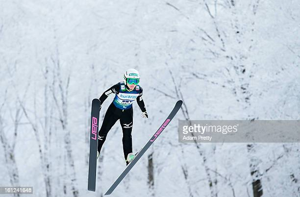 Sara Takanashi of Japan jumps on her way to victory during day two of the FIS Women's Ski Jumping World Cup at Zao Jump Stadium on February 10 2013...