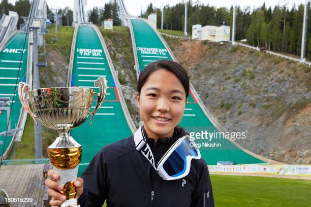 Sara Takanashi of Japan poses for a photo with a cup after her win in the FIS Ski Jumping Grand Prix Womens on September 14 2013 in Nizhni Tagil...