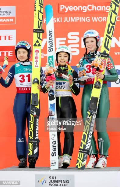 Sara Takanashi of Japan poses on the podium after picking up her 53rd career World Cup victory in Pyeongchang South Korea on Feb 16 alongside...