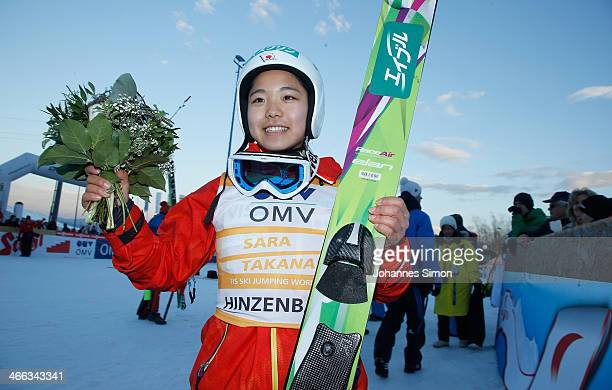 Sara Takanashi of Japan smiles to supporters after winning the Normal Hill Individual FIS Women's Ski Jumping World Cup competition at Hinzenbach...