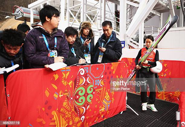 Sara Takanashi of Japan speaks to Japanese media after the Ladies' Normal Hill Individual Ski Jumping training on day 2 of the Sochi 2014 Winter...
