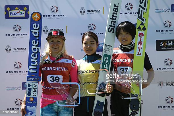 Sara Takanashi of Japan takes 1st place Chiara Hoelzl of Austria takes 2nd place Yuki Ito of Japan takes 3rd place during the Finals of the FIS Grand...