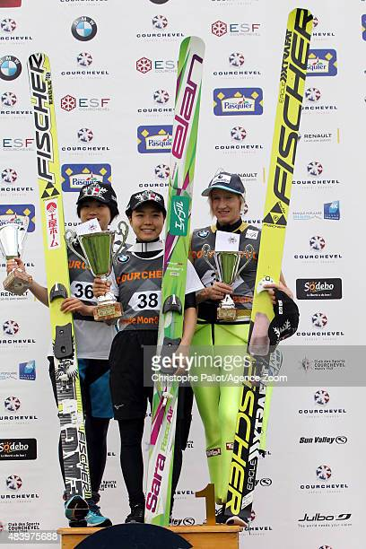 Sara Takanashi of Japan takes 1st place Ito Yuki of Japan takes 2nd place Daniela IraschikoStolz of Austria takes 3rd place during the FIS Ski...