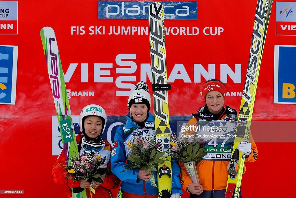 Sara Takanashi of Japan takes 2nd place, Daniela Iraschko-Stolz of Austria takes 1st place, Carina Vogt of Germany takes 3rd place during the FIS Ski Jumping World Cup Women's HS95 on January 25, 2014 in Planica, Slovenia.