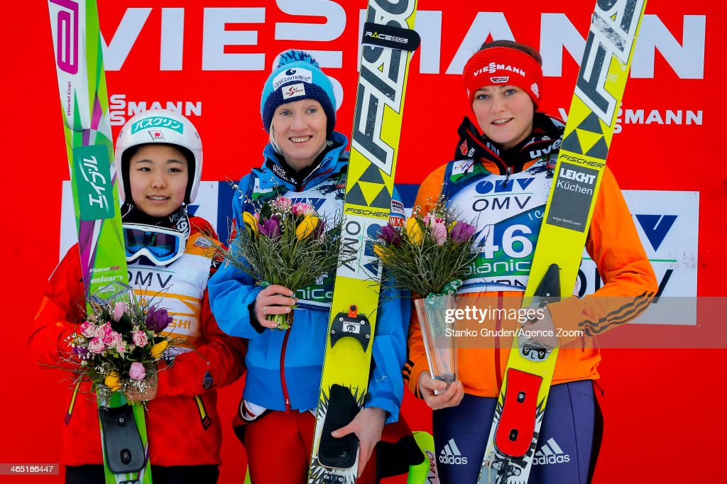 Sara Takanashi of Japan takes 2nd place Daniela IraschkoStolz of Austria takes 1st place Carina Vogt of Germany takes 3rd place during the FIS Ski...