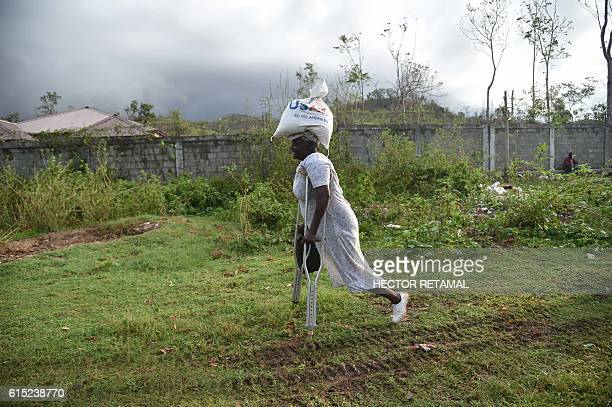 TOPSHOT Sara walks after receiving a food delivery for the World Food Programme in the commune of Maniche in Les Cayes in the south west of Haiti on...
