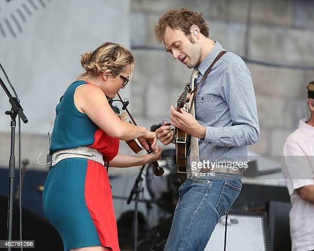 Sara Watkins and Chris Thile of Nickel Creek perform during the 2014 Newport Folk Festival at Fort Adams State Park on July 26 2014 in Newport Rhode...