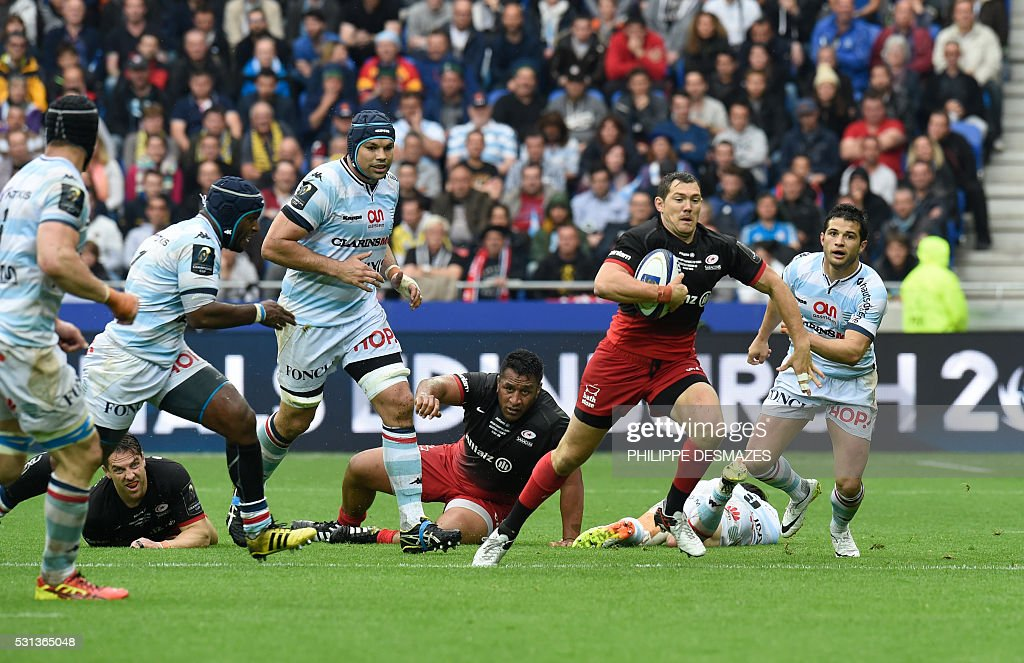 Saracens' Alex Goode runs with the ball during the European Rugby Champions Cup match beetween Racing Metro 92 and Saracens FC at the Parc Olympique...