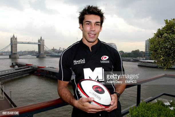 Saracens' Alex Sanderson poses with the new shirt after the sponsors launch