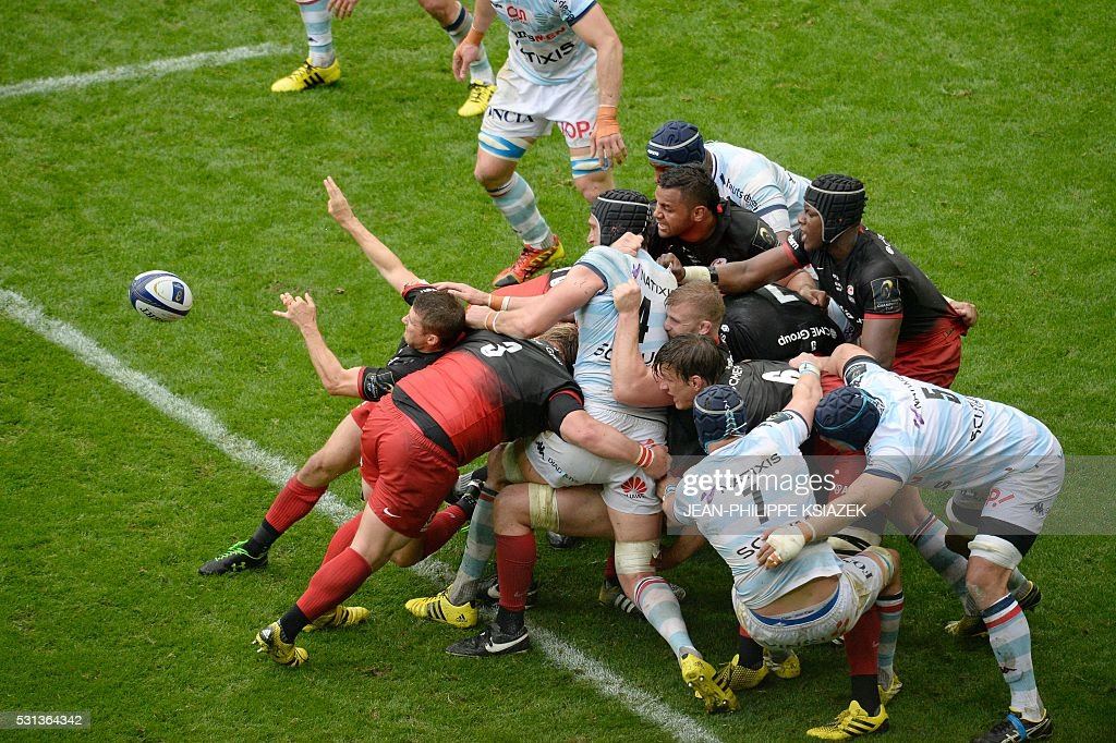 Saracens' and Racing Metro's players vie for the ball during the European Rugby Champions Cup match beetween Racing Metro 92 and Saracens FC at the...