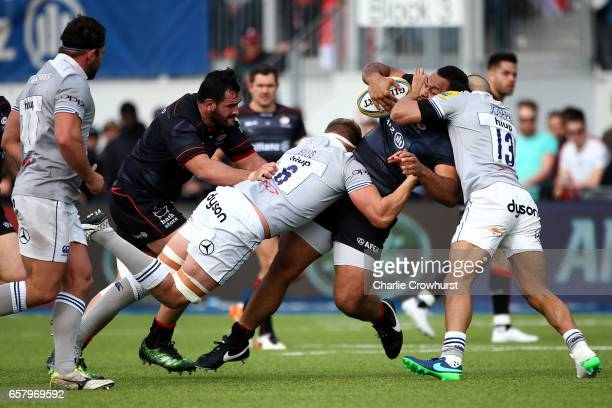 Saracens Billy Vunipola looks to break through the Bath defence of Tom Ellis and Jonathan Joseph during the Aviva Premiership match between Saracens...