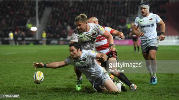Saracens captain Brad Barritt jumps on a loose ball during the Aviva Premiership match between Gloucester Rugby and Saracens at Kingsholm Stadium on...