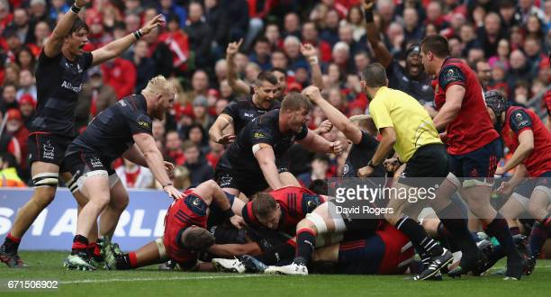 Saracens celebrate after Mako Vunipola scores the first try during the European Rugby Champions Cup semi final match between Munster and Saracens at...