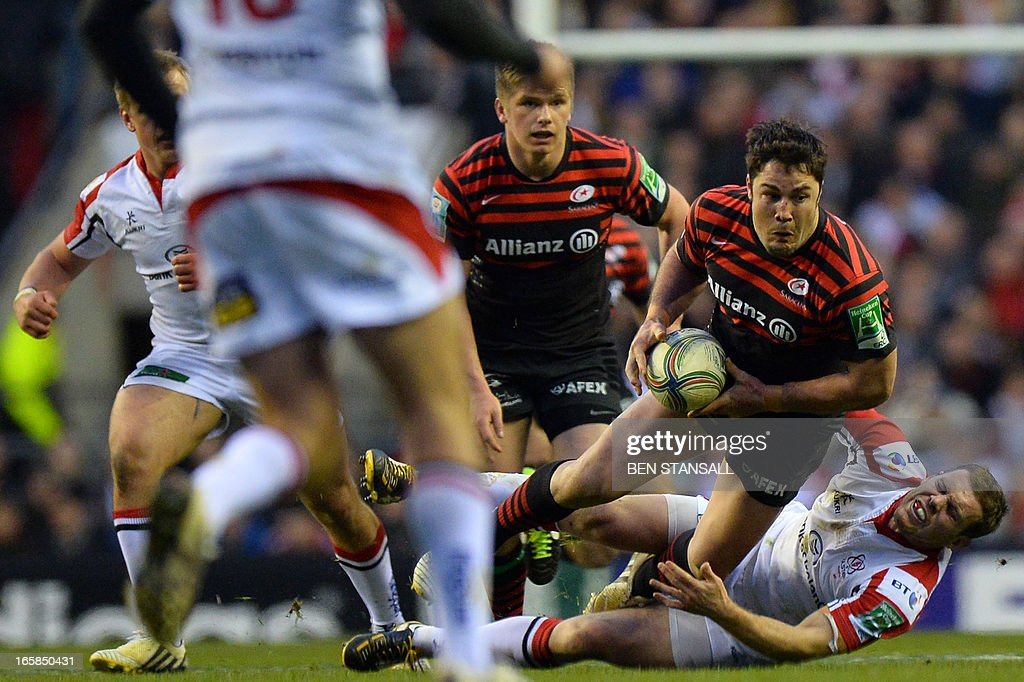 Saracens' centre Brad Barritt (2nd R) battles with Ulster's centre Darren Cave (R) during the European Cup rugby union quarter final match between Saracens and Ulster Rugby at Twickenham Stadium, southwest of London, on April 6, 2013.