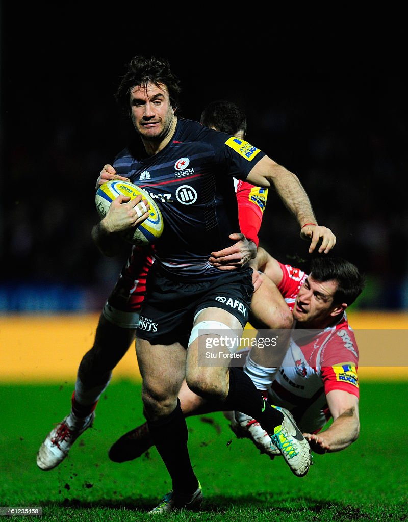 Saracens centre <a gi-track='captionPersonalityLinkClicked' href=/galleries/search?phrase=Marcelo+Bosch&family=editorial&specificpeople=820246 ng-click='$event.stopPropagation()'>Marcelo Bosch</a> breaks through the tackles of <a gi-track='captionPersonalityLinkClicked' href=/galleries/search?phrase=Jonny+May&family=editorial&specificpeople=5813545 ng-click='$event.stopPropagation()'>Jonny May</a> and Mark Atkinson (r) of Gloucester during the Aviva Premiership match between Gloucester Rugby and Saracens at Kingsholm Stadium on January 9, 2015 in Gloucester, England.