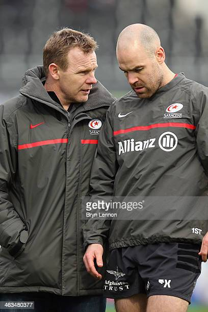 Saracens Director of Rugby Mark McCall chats to Charlie Hodgson prior to the Heineken Cup round 6 match between Saracens and Connacht at Allianz Park...