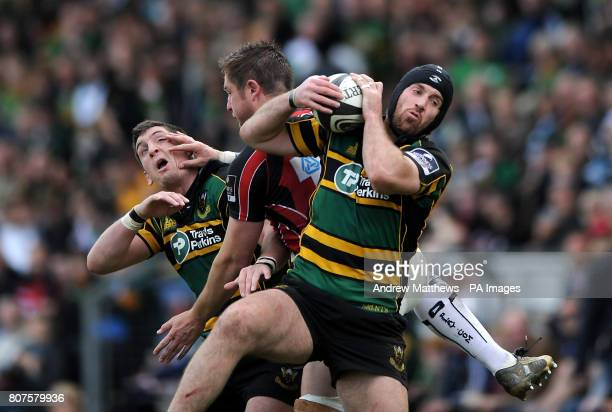 Saracens' Ernst Joubert is sandwiched in between Northampton Saints' Ignacio Fernandez Lobbe and James Downey in a battle for the ball during the...