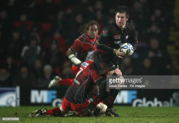 Saracens' Ernst Joubert is tackled by Toulon's Cedric Beal during the Amlin Challenge Cup match at Vicarage Road Stadium Watford