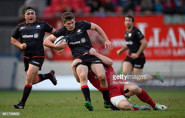 Saracens fly half Owen Farrell breaks a tackle on his way to setting up the final Saracens try during the European Rugby Champions Cup match between...